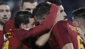 Roma's Kevin Strootman, foreground, right, celebrates with teammates after scoring his side's second goal during an Italian Serie A soccer match between AS Roma and Spal, at the Olympic stadium in Rome, Friday, Dec. 1st, 2017. (AP Photo/Gregorio Borgia)