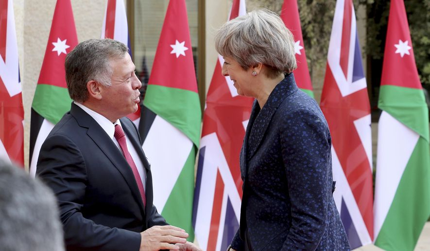 British Prime Minister Theresa May meets King Abdullah at the Royal Palace in Amman, Jordan during her visit to the Middle East, Thursday, Nov. 30, 2017. (AP Photo/Raad Adayleh)