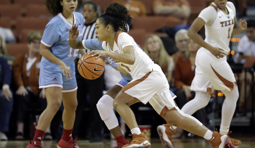 Texas guard Brooke McCarty (11) drives the ball against Louisiana Tech during the second half of an NCAA college basketball game, Thursday, Nov. 30, 2017, in Austin, Texas. Texas won 88-54. (AP Photo/Eric Gay)