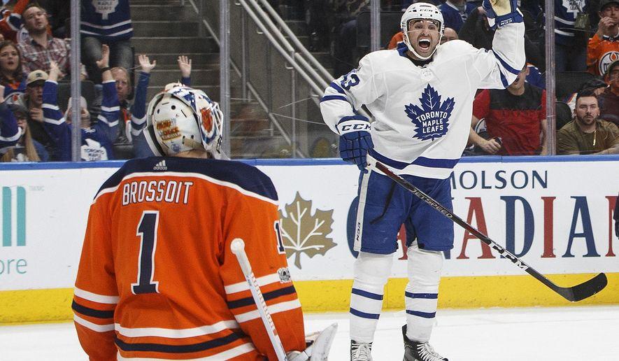 Toronto Maple Leafs' Nazem Kadri (43) celebrates a goal against Edmonton Oilers goalie Laurent Brossoit (1) during the third period of an NHL hockey game Thursday, Nov. 30, 2017, in Edmonton, Alberta. (Jason Franson/The Canadian Press via AP)