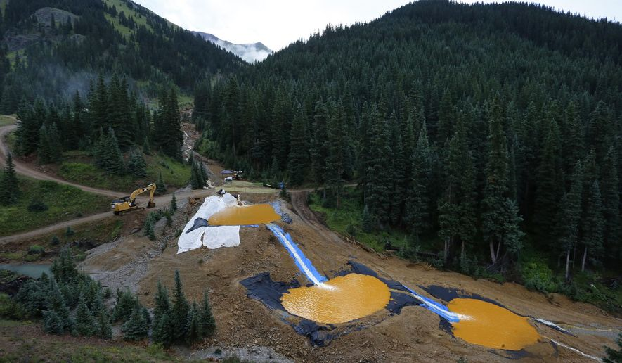 FILE - In this Aug. 12, 2015 file photo, water flows through a series of retention ponds built to contain and filter out heavy metals and chemicals from the Gold King mine chemical accident, in the spillway about 1/4 mile downstream from the mine, outside Silverton, Colo. The administration of President Donald Trump is dropping a proposal that would have forced mining companies to prove they have the financial wherewithal to clean up their pollution, Friday, Dec. 1, 2017. (AP Photo/Brennan Linsley, File)