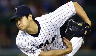 FILE - In this Nov. 19, 2015, file photo, Japan's starter Shohei Otani pitches against South Korea during the first inning of their semifinal game at the Premier12 world baseball tournament at Tokyo Dome in Tokyo. A person familiar with the decision says Major League Baseball owners on Friday, Dec. 1, 2017, have approved a new posting agreement with their Japanese counterparts in a move that allows bidding to start for coveted pitcher and outfielder Shohei Ohtani.   The person spoke on condition of anonymity because no announcement had been made. (AP Photo/Shizuo Kambayashi, File) **FILE**