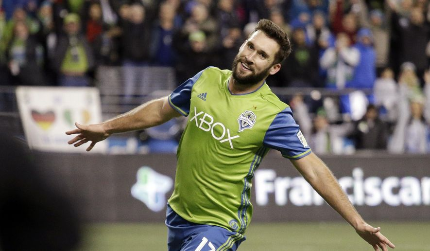 Seattle Sounders' Will Bruin smiles after scoring against the Houston Dynamo during the second half of the second leg of the MLS soccer Western Conference final, Thursday, Nov. 30, 2017, in Seattle. (AP Photo/Elaine Thompson)