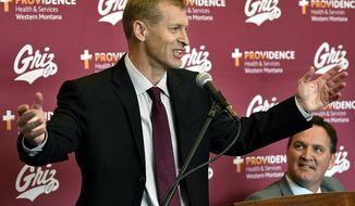 New Montana football coach Bobby Hauck speaks during a press conference Friday, Dec. 1, 2017, at the University of Montana in Missoula, Mont. Beside Hauck is Montana athletic director Kent Haslam. (Kurt Wilson/The Missoulian via AP)