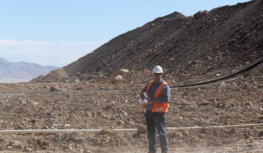 In this Oct. 5, 2017 photo, Marigold Mine Chief Surveyor Alan Clayson lands a drone near a leach pad at the Marigold Mine in Valmy, Nev. SSR Mining Inc. began the process of incorporating unmanned aerial vehicles at the Nevada mine in January. (Suzanne Featherston/The Daily Free Press via AP)