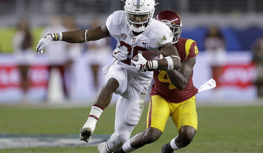 Stanford running back Bryce Love (20) runs in front of Southern California safety Chris Hawkins (4) during the first half of the Pac-12 Conference championship NCAA college football game in Santa Clara, Calif., Friday, Dec. 1, 2017. (AP Photo/Marcio Jose Sanchez)