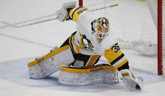 Pittsburgh Penguins goalie Tristan Jarry makes a glove save during the third period of an NHL hockey game against the Buffalo Sabres, Friday Dec. 1, 2017, in Buffalo, N.Y. (AP Photo/Jeffrey T. Barnes)