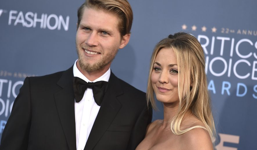 FILE - In this  Dec. 11, 2016, file photo, Kaley Cuoco, right, and Karl Cook arrive at the 22nd annual Critics' Choice Awards at the Barker Hangar in Santa Monica, Calif. The couple announced their engagement on Nov. 30, 2017. (Photo by Jordan Strauss/Invision/AP, File)