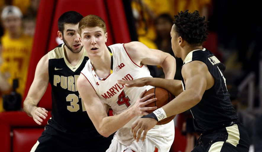 Maryland guard Kevin Huerter, center, tries to protect the ball from Purdue guards Carsen Edwards, right, and Dakota Mathias in the first half of an NCAA college basketball game in College Park, Md., Friday, Dec. 1, 2017. (AP Photo/Patrick Semansky) **FILE**