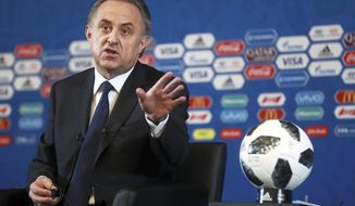 Vitaly Mutko, Russian Federation Deputy Prime Minister & Local Organising Committee Chairman gestures during a press conference ahead of the 2018 soccer World Cup draw in the Kremlin in Moscow, Friday Dec. 1, 2017. (AP Photo)