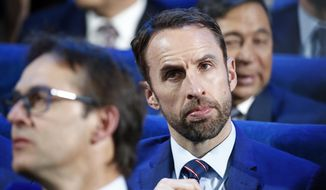 England's soccer team coach Gareth Southgate attends the 2018 soccer World Cup draw in the Kremlin in Moscow, Friday Dec. 1, 2017. (AP Photo/Pavel Golovkin)