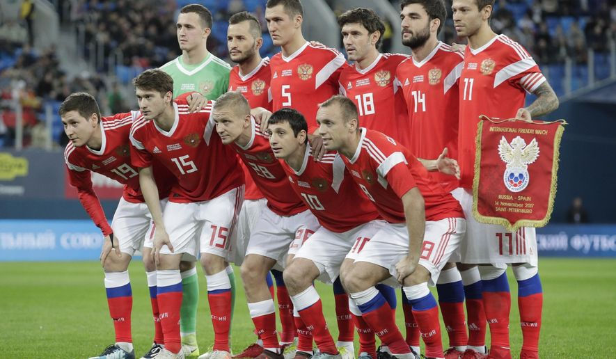 FILE - In this Tuesday, Nov. 14, 2017 filer Russia's players pose for a team photo prior to the international friendly soccer match between Russia and Spain in St.Petersburg, Russia. (AP Photo/Dmitri Lovetsky)