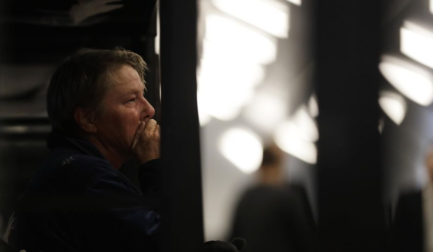 Verna Vasbinder looks on from her new bunk in the city's new Temporary Bridge Shelter for the homeless Friday, Dec. 1, 2017, in San Diego. The first of three shelters opened Friday, which will eventually provide beds for up to 700 people, as the city struggles to control a homeless crisis gripping the region. (AP Photo/Gregory Bull)