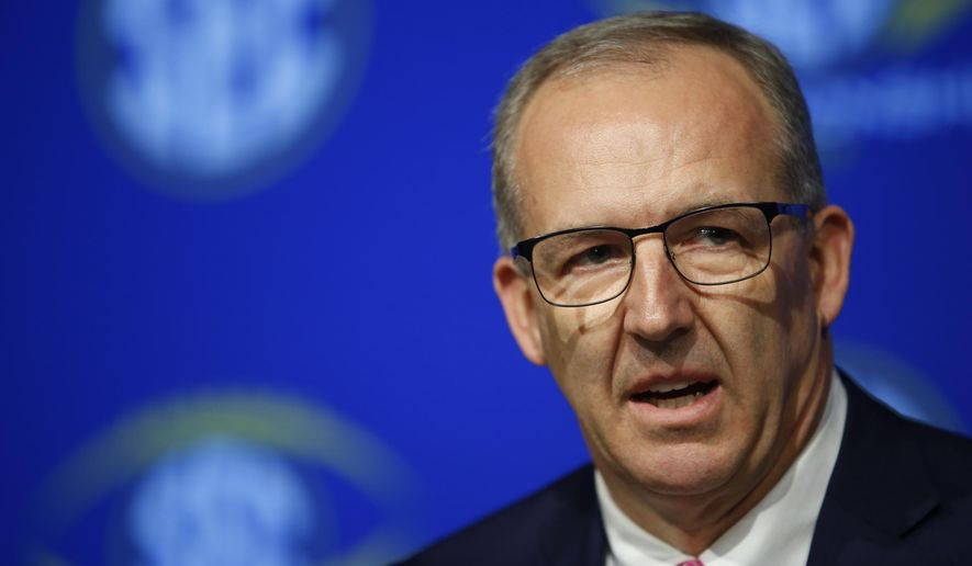 SEC Commissioner Greg Sankey speaks with the media during an NCAA college football news conference for the Southeastern Conference championship game at the Mercedes-Benz Stadium in Atlanta,  Friday, Dec. 1, 2017. Auburn and Georgia meet on Saturday for the SEC title. (Joshua L. Jones,/Athens Banner-Herald via AP)
