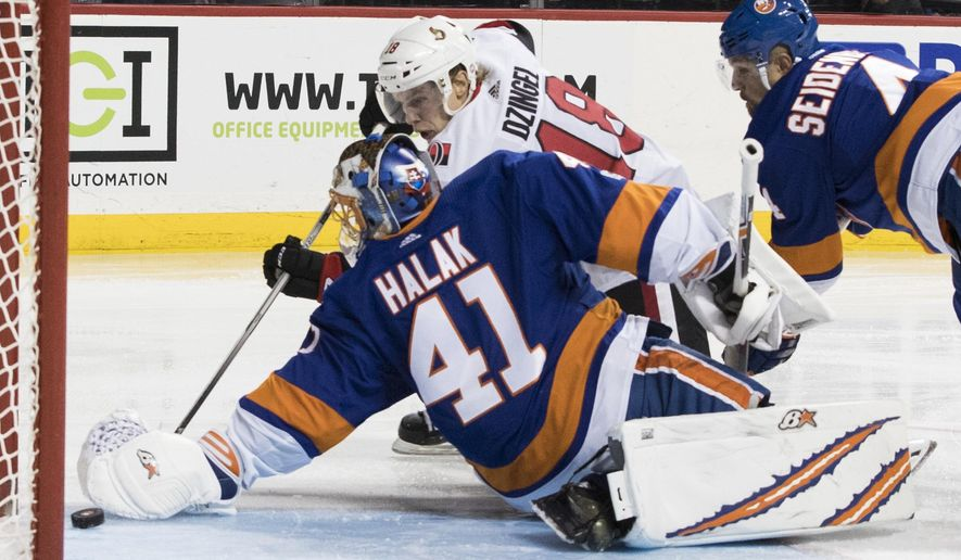 Ottawa Senators left wing Ryan Dzingel (18) scores the winning goal past New York Islanders goalie Jaroslav Halak (41) during the third period of an NHL hockey game, Friday, Dec. 1, 2017, in New York. (AP Photo/Mary Altaffer)