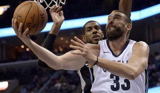 Memphis Grizzlies center Marc Gasol (33) shoots against San Antonio Spurs forward LaMarcus Aldridge during the second half of an NBA basketball game Friday, Dec. 1, 2017, in Memphis, Tenn. (AP Photo/Brandon Dill)