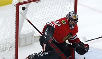 Chicago Blackhawks' Corey Crawford allows a goal by Dallas Stars' Mattias Janmark during overtime of an NHL hockey game Thursday, Nov. 30, 2017, in Chicago. The Stars won 4-3. (AP Photo/Jim Young)