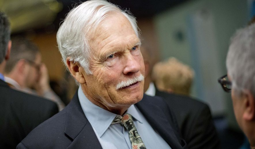 FILE - In this Friday, Dec. 6, 2013, file photo, media mogul Ted Turner talks with guests at the Captain Planet Foundation benefit gala in Atlanta.  Turner has pledged to sell an island to the state of South Carolina to supplement the severely eroding, widely popular Hunting Island State Park. On Thursday, Nov. 30, 2017,  the state Department of Parks, Recreation and Tourism has asked state legislators to pay $5 million for St. Phillips Island. Turner has owned the 4,682-acre barrier island outside Beaufort since 1979 and listed it in 2014 for $24 million. (AP Photo/David Goldman, File)