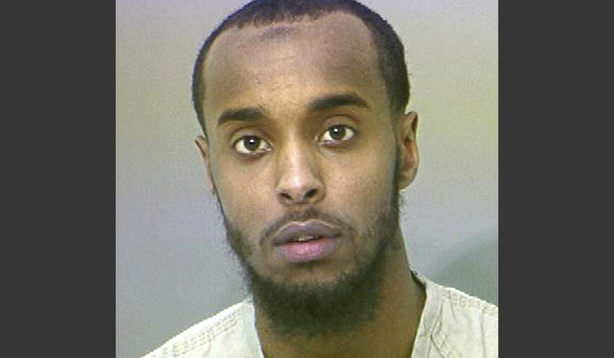 FILE - This undated file photo provided by the Franklin County Sheriff's Office shows Abdirahman Sheik Mohamud. A federal judge has excused himself from the case of the Ohio man who admitted he plotted to kill military members in the U.S. Judge James Graham filed the notice of recusal in federal court Wednesday, Nov. 30, 2017, without explanation in the case of defendant Mohamud. Mohamud pleaded guilty in August 2015 to supporting terrorism and making false statements to authorities. (AP Photo/Franklin County Sheriff's Office via AP, File)