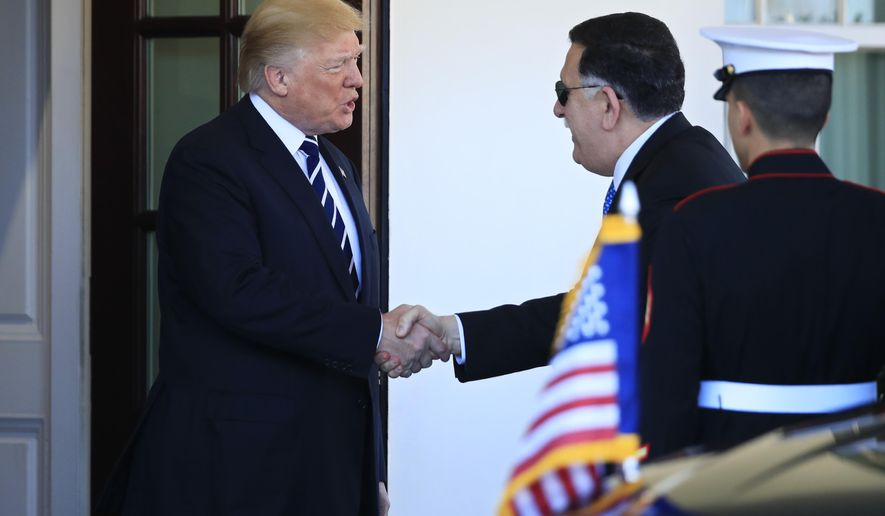 President Donald Trump greets Libyan Prime Minister Fayez al-Sarraj, at the entrance of the West Wing at the White House in Washington, Friday, Dec. 1, 2017. (AP Photo/Manuel Balce Ceneta)