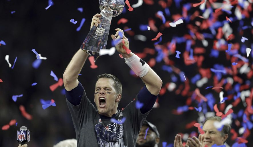 2017 AP YEAR END PHOTOS - New England Patriots' Tom Brady raises the Vince Lombardi Trophy after defeating the Atlanta Falcons in overtime at the NFL Super Bowl 51 football game on Feb. 5, 2017, in Houston. The Patriots defeated the Falcons 34-28. (AP Photo/Darron Cummings)