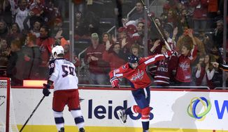 Washington Capitals right wing Brett Connolly (10) celebrates his goal next to Columbus Blue Jackets defenseman David Savard (58) during the first period of an NHL hockey game, Saturday, Dec. 2, 2017, in Washington. (AP Photo/Nick Wass)