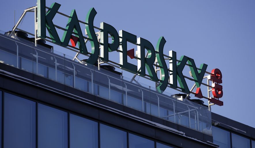 This Monday, Jan. 30, 2017, file photo shows a sign above the headquarters of Kaspersky Lab in Moscow. Britain's cybersecurity agency has told government departments not to use antivirus software from Moscow-based firm Kaspersky Lab, it was reported Saturday, Dec. 2, 2017. (AP Photo/Pavel Golovkin, File)