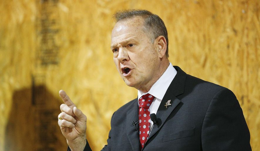 FILE - In this Thursday, Nov. 30, 2017 file photo, former Alabama Chief Justice and U.S. Senate candidate Roy Moore speaks at a campaign rally, in Dora, Ala. Federal fundraising reports released Friday, Dec. 1, reveal that Moore is losing the battle for campaign cash to Democrat Doug Jones. And he's losing badly. (AP Photo/Brynn Anderson, File)