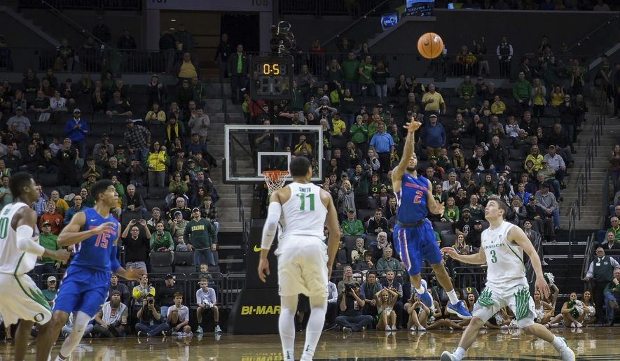 Boise State's Lexus Williams hits a buzzer-beater to defeat Oregon 73-70, snapping the Ducks' 46-game home winning streak, in Eugene, Ore., Friday, Dec. 1, 2017. (Brian Davies/The Register-Guard via AP)