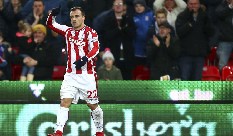 Stoke City's Xherdan Shaqiri celebrates scoring his side's first goal of the game against Swansea during the English Premier League soccer match at the Bet35 Stadium, Stoke, England, Saturday, Dec. 2, 2017. (Dave Thompson/PA via AP)