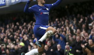 Chelsea's Eden Hazard celebrates scoring his side's first goal of the game during the English Premier League soccer match between Chelsea and Newcastle United at Stamford Bridge, London. Saturday. Dec. 2, 2017. (Steven Paston/PA via AP)