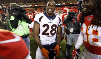 """FILE - In this Oct. 30, 2017, file photo, Denver Broncos running back Jamaal Charles (28), a former Chiefs player, meets with Kansas City Chiefs running back Charcandrick West, left, and defensive back Ron Parker (38) following an NFL football game in Kansas City, Mo. Charles no longer hides the challenges of his childhood that included relentless teasing over his disability and the lifeline provided by Special Olympics, where he learned he could overcome any obstacle. Now boasting the highest career rushing average in NFL history, Charles will wear custom cleats this weekend to spread his message as part of the NFL's """"My Cause My Cleats"""" campaign.  (AP Photo/Colin E. Braley, File)"""