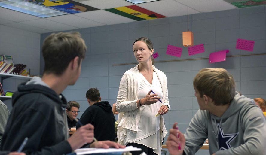 Lawton-Bronson Spanish teacher Kami Busch instructs her class in Lawton, Iowa on Wednesday, Nov. 8, 2017. Busch is teaching in a field that has been designated as a shortage area in Iowa. (Justin Wan/Sioux City Journal via AP)