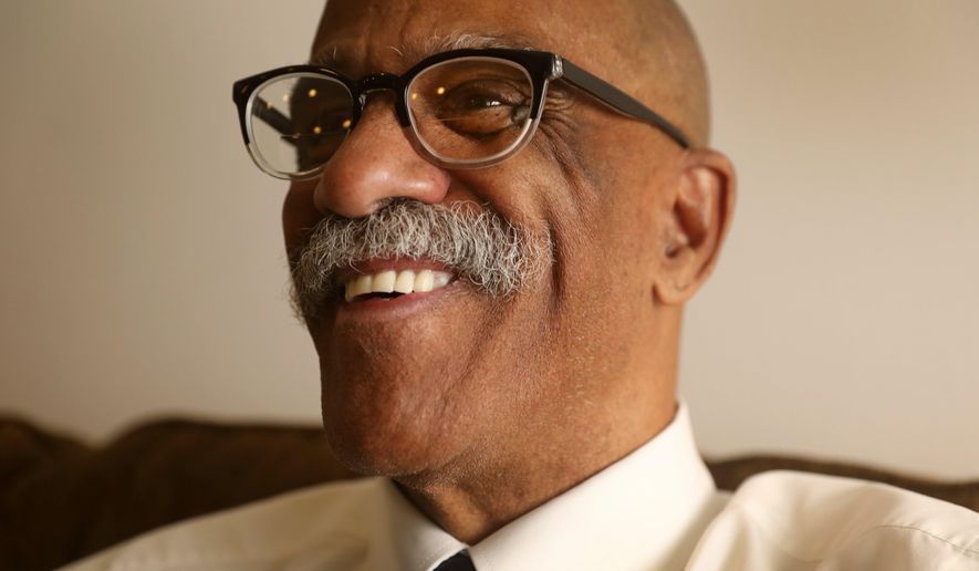 In this Tuesday, Nov. 21, 2017 photo, Jack Coleman smiles in his apartment in SeaTac, Wash. Coleman, who 27 years in the Army, lived in a Salvation Army shelter before receiving permanent housing. (Ken Lambert/The Seattle Times via AP)