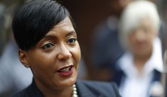 FILE - In this Tuesday, Nov. 7, 2017, file photo, Atlanta city councilwoman and mayoral candidate Keisha Lance Bottoms talks to the press after voting at a polling site in Atlanta. Bottoms is in a runoff with Mary Norwood. (AP Photo/David Goldman, File)