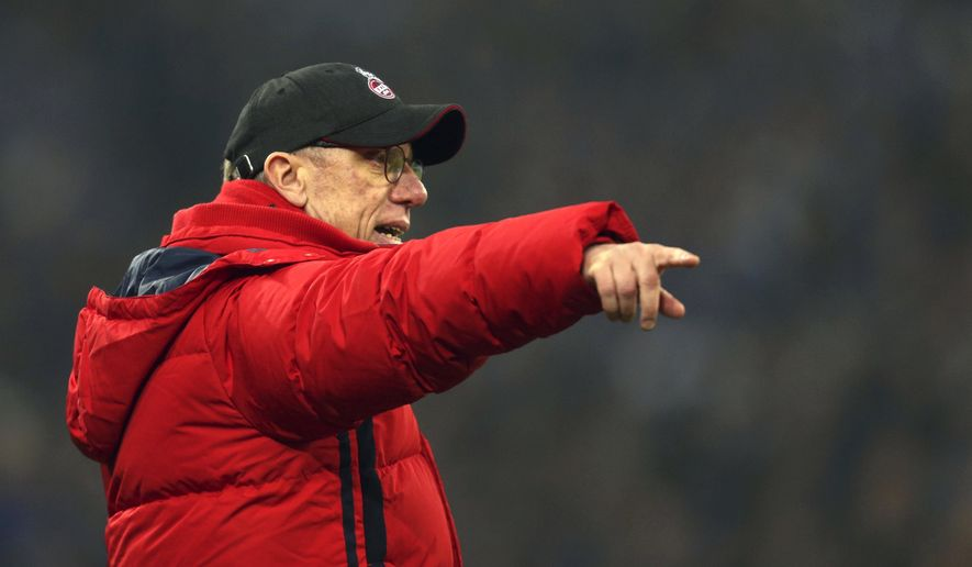 Cologne coach Peter Stoeger gestures at the edge of the pitch during the German Bundesliga football match between FC Schalke 04 and 1. FC Cologne at the Veltins Arena in Gelsenkirchen, Germany, Saturday Dec. 2, 2017. (Ina Fassbender/dpa via AP)
