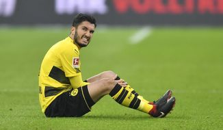 Dortmund's Nuri Sahin reacts during the German Bundesliga soccer match between Bayer Leverkusen and Borussia Dortmund in Leverkusen, Germany, Saturday, Dec. 2, 2017. (AP Photo/Martin Meissner)
