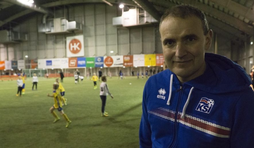 Iceland President Gudni Thorlacius Johannesson poses for a photo during a tournament in Kopavogur on the outskirts of Reykjavik, Sunday, Nov. 26, 2017. The matches at the Korinn indoor hall are watched by proud parents, catching up with friends and relatives _ faces are familiar in a country this small, and that includes Iceland President Gudni Thorlacius Johannesson, who was there to watch his 8-year-old son. (AP Photo/David Keyton)
