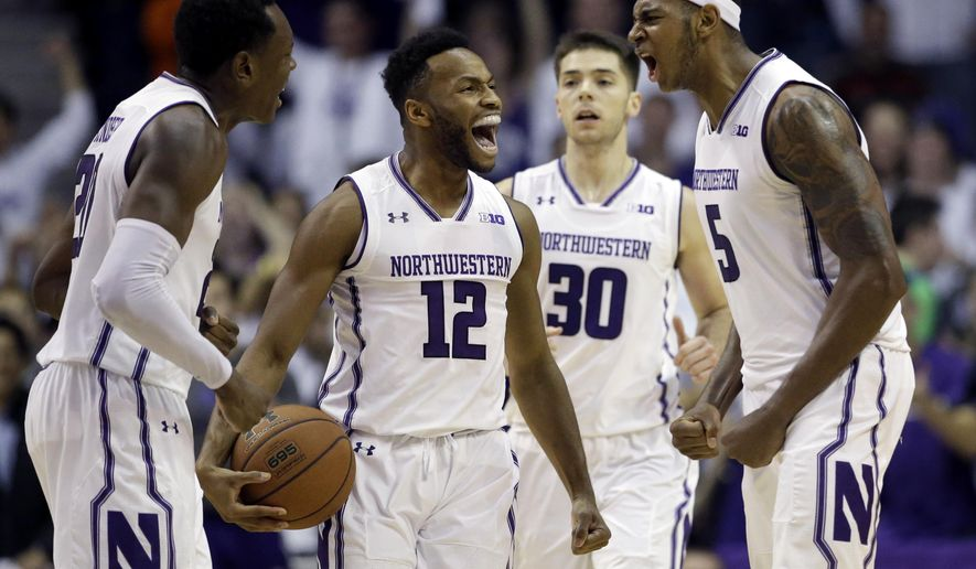 Northwestern guard Isiah Brown, center, smiles as he celebrates with guard Scottie Lindsey, left, and center Derek Pardon during overtime in the team's NCAA college basketball game against Illinois, Friday, Dec. 1, 2017, in Rosemont, Ill. Northwestern won 72-68. (AP Photo/Nam Y. Huh)