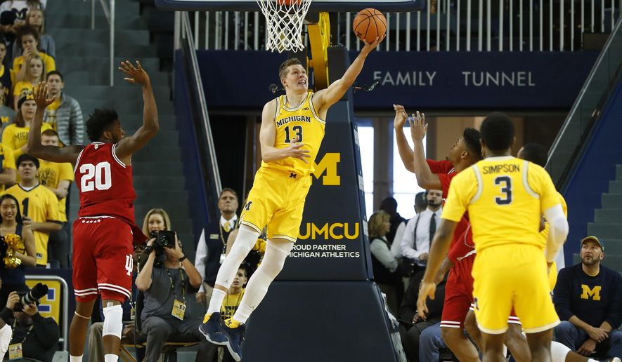 Michigan forward Moritz Wagner (13) drives to the basket against the Indiana in the first half of an NCAA basketball game in Ann Arbor, Mich., Saturday, Dec. 2, 2017. (AP Photo/Paul Sancya)