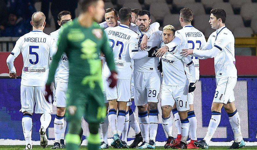 Atalanta's Josip Ilicic celebrates after scoring  during the Italian Serie A soccer match between Torino and Atalanta at the Olympic stadium in Turin, Italy, Saturday, Dec. 2, 2017. (Alessandro Di Marco/ANSA via AP)