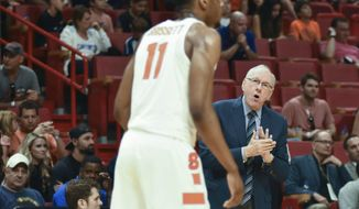 Syracuse's head coach Jim Boeheim rallies his players during the first half of an NCAA college basketball game at the HoopHall Miami Invitational tournament Saturday, Dec. 2, 2017, in Miami. Kansas won 76-60. (AP Photo/Gaston De Cardenas)