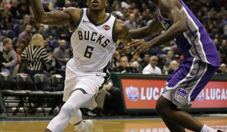 Milwaukee Bucks' Eric Bledsoe (6) drives against the Sacramento Kings during the second half of an NBA basketball game Saturday, Dec. 2, 2017, in Milwaukee. (AP Photo/Jeffrey Phelps)