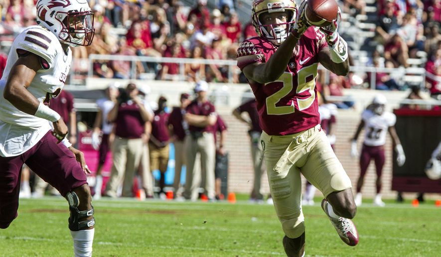 Florida State wide receiver D.J. Matthews (29) makes his first touchdown catch in front of Louisiana Monroe cornerback Marcus Hubbard during the first half of an NCAA college football game in Tallahassee, Fla., Saturday, Dec. 2, 2017. (AP Photo/Mark Wallheiser)