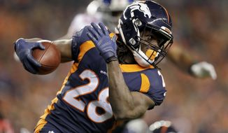 "FILE - In this Oct. 15, 2017, file photo, Denver Broncos running back Jamaal Charles runs with the ball during the first half of an NFL football game against the New York Giants in Denver. Charles no longer hides the challenges of his childhood that included relentless teasing over his disability and the lifeline provided by Special Olympics, where he learned he could overcome any obstacle. Now boasting the highest career rushing average in NFL history, Charles will wear custom cleats this weekend to spread his message as part of the NFL's ""My Cause My Cleats"" campaign.  (AP Photo/Joe Mahoney, FIle)"