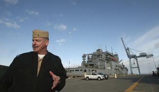 """Naval Magazine Indian Island Cmdr. Rocky Pulley talks about the process of loading and unloading ships, like the USNS Cesar Chavez behind him, at the pier on Friday, Nov. 17, 2017.  Naval Magazine Indian Island serves as the last stop for many ships where they load up on """"fuel, food and munitions"""" before heading out to the open ocean, said Pulley.   (Meegan M. Reid/Kitsap Sun via AP)"""