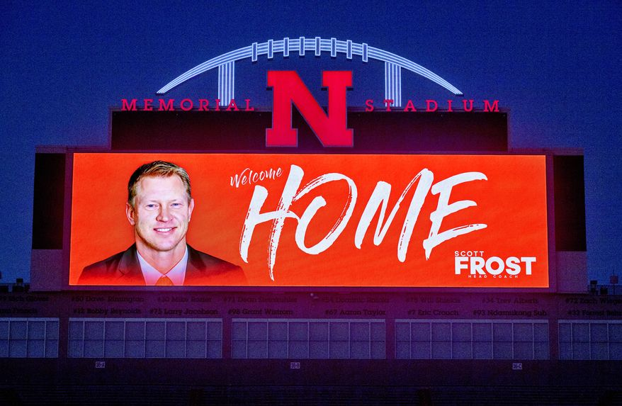 """The Memorial Stadium video board displays a """"Welcome Home"""" message to new Nebraska football coach Scott Frost on Saturday, Dec. 2, 2017, in Lincoln, Neb. Frost, the native son who quarterbacked Nebraska to a share of the national championship 20 years ago, is returning to the Cornhuskers as coach after orchestrating a stunning two-year turnaround at Central Florida. (Francis Gardler/The Journal-Star via AP)"""