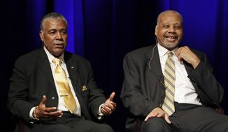 FILE - In this Sept. 27, 2016 file photo, Godfrey Dillard, left, and Perry Wallace take part in a lecture at Vanderbilt University in Nashville, Tenn.  Wallace, who broke down a racial barrier by becoming the first black varsity basketball player in the Southeastern Conference, has died. He was 69. Wallace's death was announced Friday, Dec. 1, 2017,  by Vanderbilt University, where Wallace became an all-SEC player and remains among the Commodores' all-time rebounding leaders. (AP Photo/Mark Humphrey, File) **FILE**