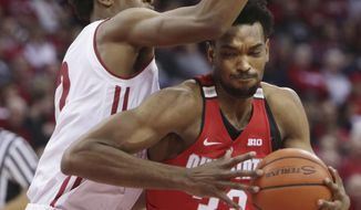 Ohio State  forward Keita Bates-Diop (33) drives to the basket past the defense of Wisconsin forward Aleem Ford (2) in the first half of an NCAA college basketball game in Madison, Wis., Saturday, Dec. 2, 2017. (Amber Arnold/Wisconsin State Journal via AP)