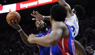 Detroit Pistons' Andre Drummond (0) is blocked by Philadelphia 76ers' Joel Embiid (21) during the first half of an NBA basketball game, Friday, Dec. 2, 2017, in Philadelphia. (AP Photo/Michael Perez)